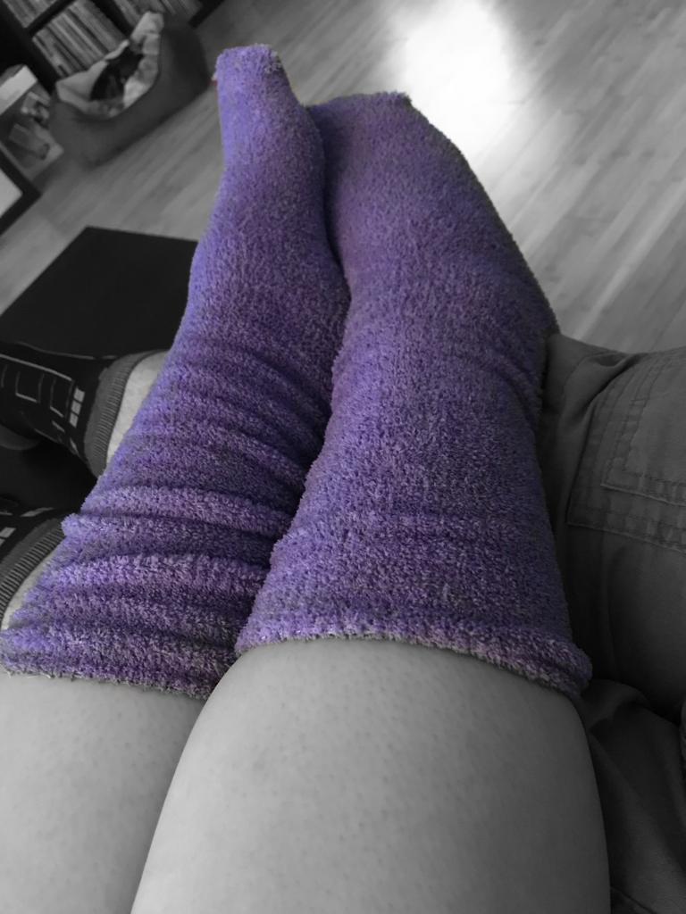 Her purple fuzzy foot warmers